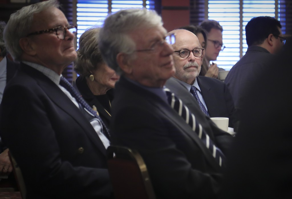 Associated Press photojournalist and Pulitzer Prize winner Richard Drew, center, a 2019 inductee into The Deadline Club Hall of Fame, sit with fellow ...