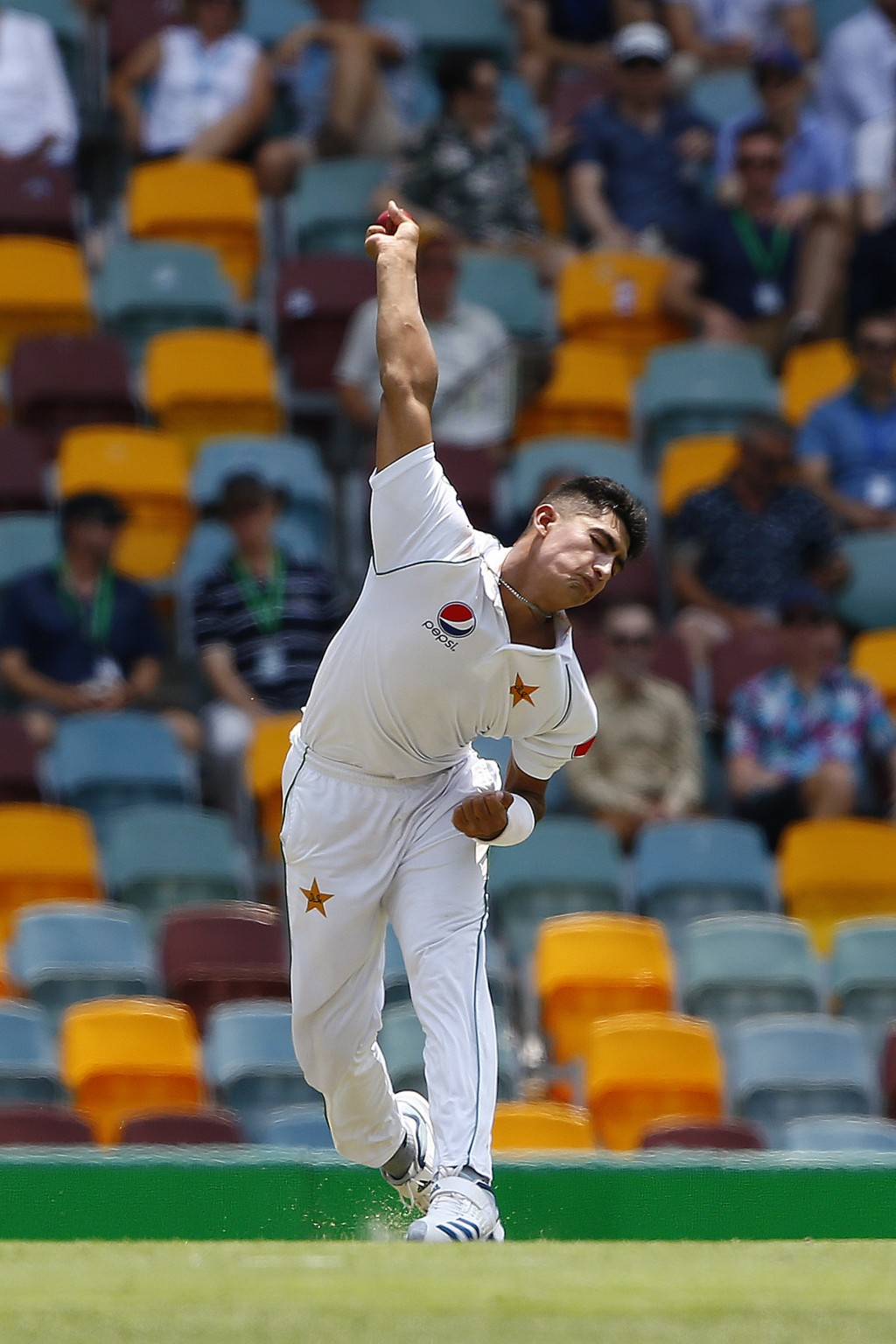 Pakistan's Naseem Shah bowls during their cricket test match against Australia in Brisbane, Australia, Friday, Nov. 22, 2019. (AP Photo/Tertius Pickar...