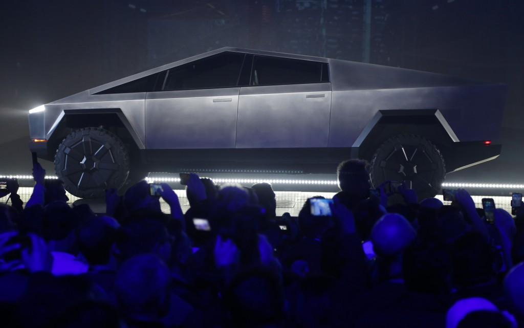 The Tesla Cybertruck is unveiled at Tesla's design studio Thursday, Nov. 21, 2019, in Hawthorne, Calif. CEO Elon Musk is taking on the workhorse heavy...
