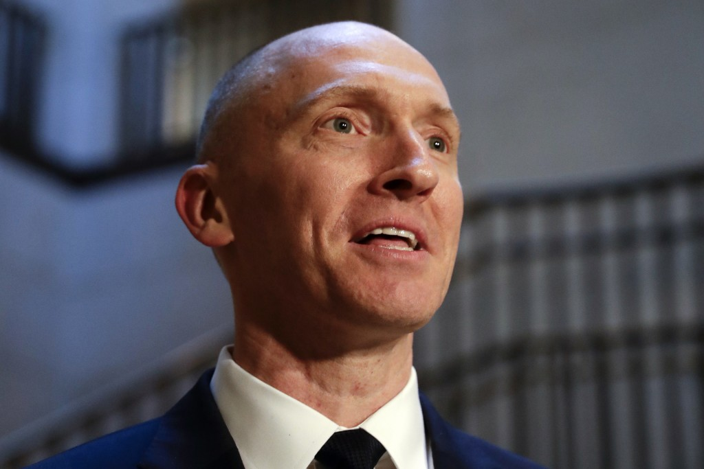 FILE - In this Nov. 2, 2017, photo, Carter Page, a foreign policy adviser to Donald Trump's 2016 presidential campaign, speaks with reporters followin...