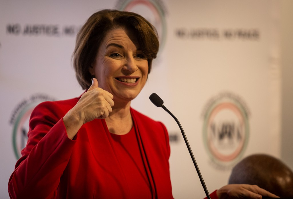 Amy Klobuchar gestures to an audience at a breakfast event on Thursday, Nov. 21, 2019, in Atlanta. Klobuchar, along with Pete Buttigieg, Cory Booker, ...