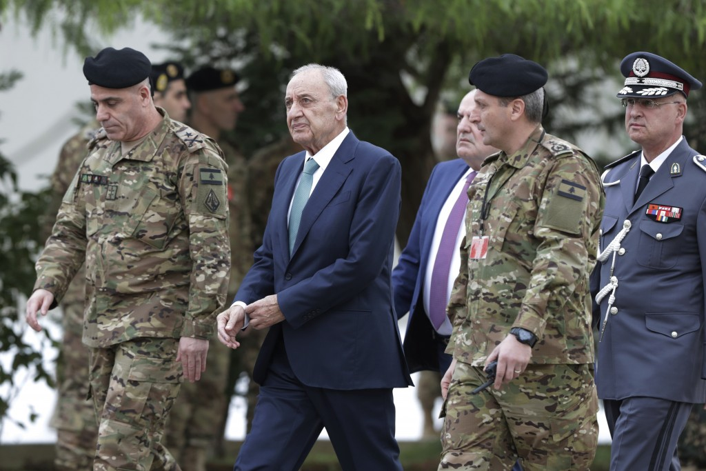 Lebanese Parliament Speaker Nabih Berri, center, arrives to attend a military parade to mark the 76th anniversary of Lebanon's independence from Franc...
