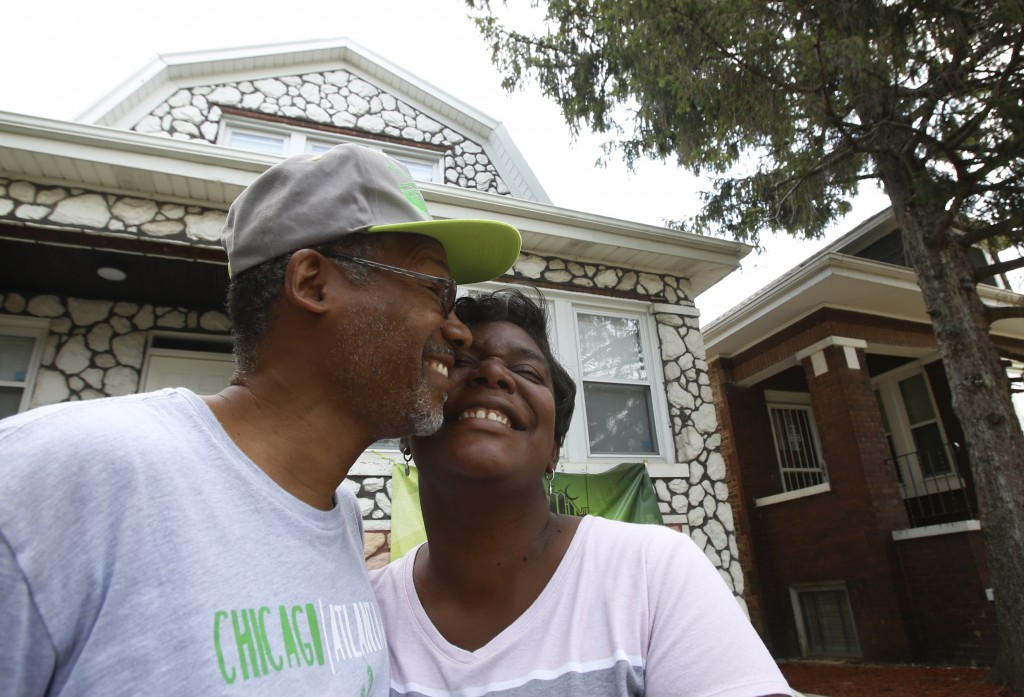 Hasan and Mary Smith stand cheek to cheek outside their newly rehabbed home in the Chicago Lawn neighborhood of Chicago on Sept. 11, 2019. The home is...