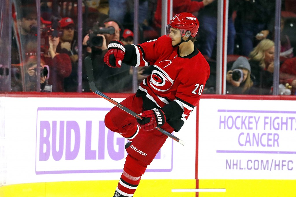 Carolina Hurricanes' Sebastian Aho (20), of Finland, celebrates a goal against the Philadelphia Flyers during the first period of an NHL hockey game i...