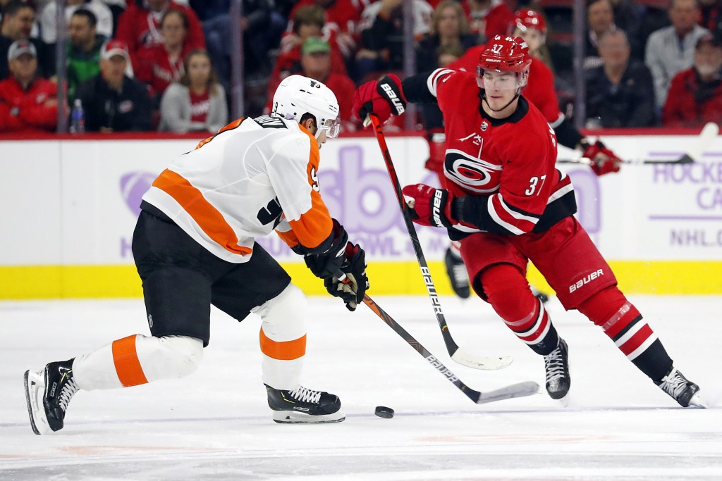 Carolina Hurricanes' Andrei Svechnikov (37), of Russia, works the puck as Philadelphia Flyers' Ivan Provorov (9), of Russia, defends during the second...