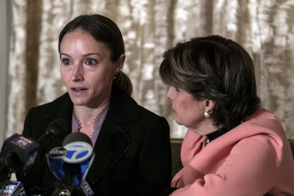 Teala Davies, left, speaks as her attorney Gloria Allred, right, listens during a news conference, Thursday, Nov. 21, 2019, in New York, about the fil...