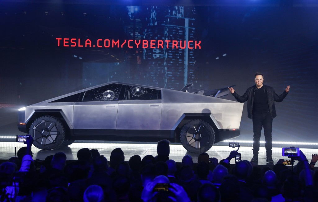 FILE - In this Nov. 21, 2019 file photo, Tesla CEO Elon Musk introduces the Cybertruck at Tesla's design studio in Hawthorne, Calif.  The much-hyped u...