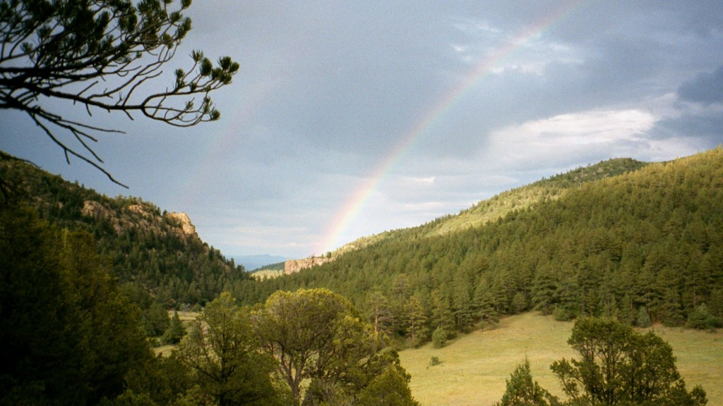 FILE - In this July 2001 file photo, a double rainbow is shown in the early evening in Philmont Scout Ranch, N.M. The vast Philmont Scout Ranch,  one ...