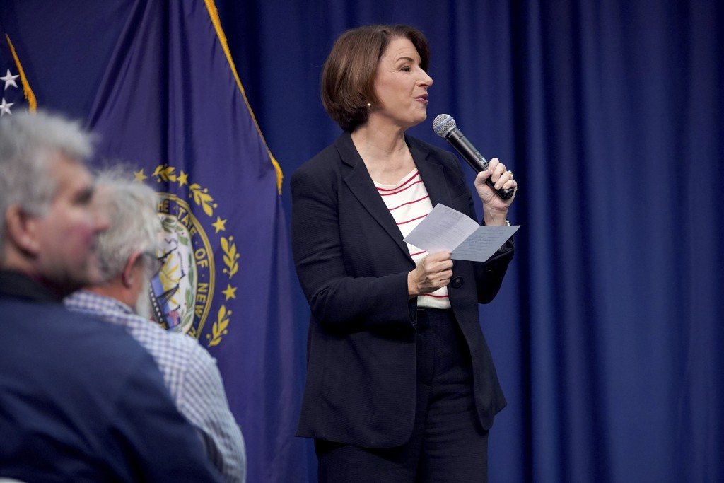 Democratic presidential candidate Sen. Amy Klobuchar, D-Minn., responds to a question she pulled from a bucket during a campaign stop, Friday, Nov. 22...