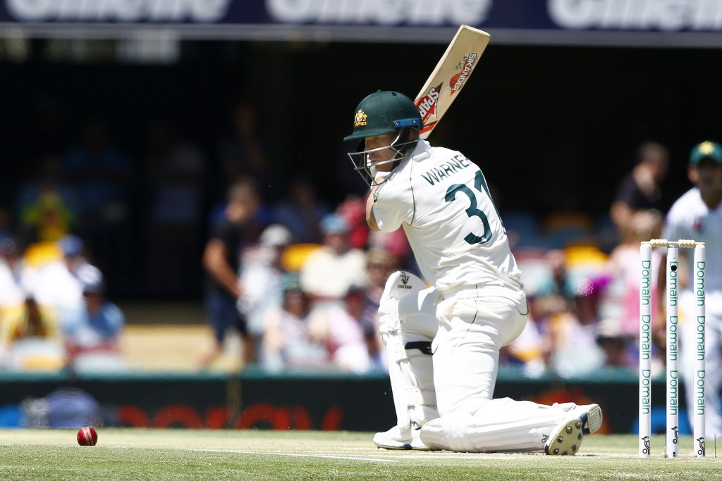Australia's David Warner plays a shot during their cricket test match against Pakistan in Brisbane, Australia, Saturday, Nov. 23, 2019. (AP Photo/Tert...