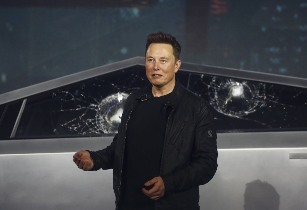 FILE - In this Nov. 21, 2019 file photo, Tesla CEO Elon Musk introduces the Cybertruck at Tesla's design studio in Hawthorne, Calif. Musk is taking on...