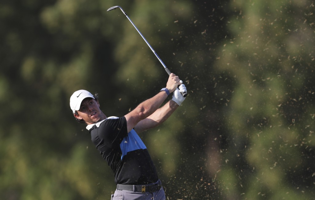 Rory McIlroy of Northern Ireland plays a shot on the 16th hole during the third round of the DP World Tour Championship golf tournament in Dubai, Unit...