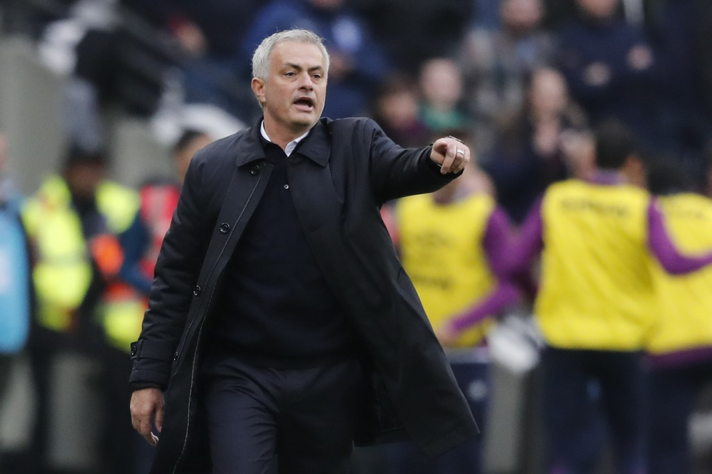 Tottenham's manager Jose Mourinho calls out to his players during the English Premier League soccer match between West Ham and Tottenham, at London st...