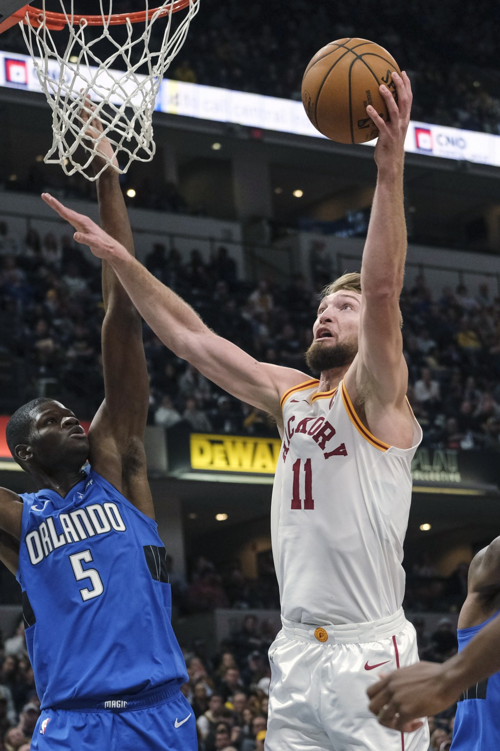Indiana Pacers forward Domantas Sabonis (11) shoots around Orlando Magic center Mo Bamba (5) during the second half of an NBA basketball game in India...