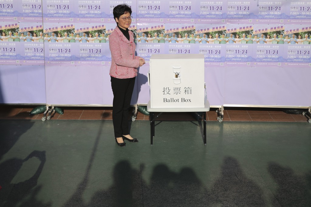 Hong Kong Chief Executive Carrie Lam casts her ballot at a polling place in Hong Kong, Sunday, Nov. 24, 2019. Voting was underway Sunday in Hong Kong ...