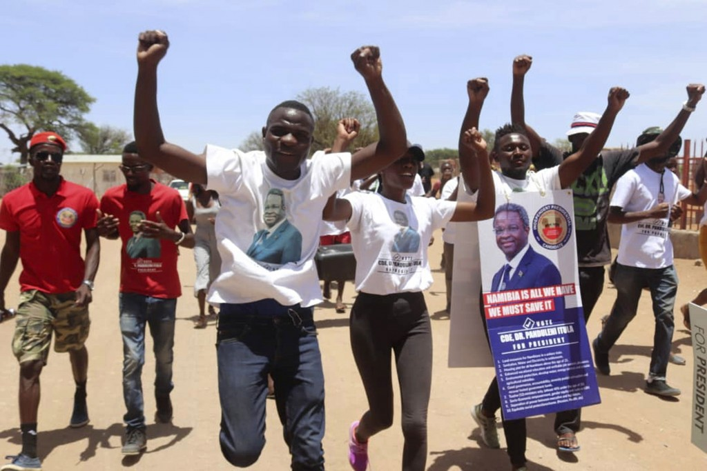 In this Wednesday, Nov. 20, 2019, photo, supporters of independent candidate Dr. Panduleni Itula cheer on a street in Gobabis, Namibia. Namibia votes ...