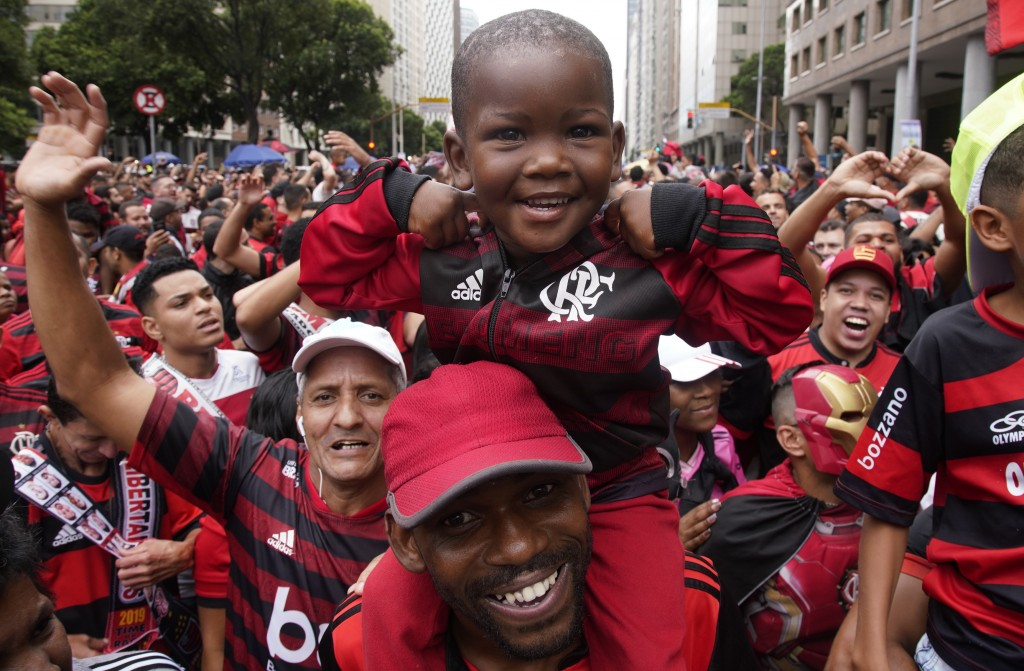 Fans of Brazil's Flamengo cheer as they wait for their arrival in Rio de Janeiro, Brazil, Sunday, Nov. 24, 2019. Flamengo overcame Argentina's River P...