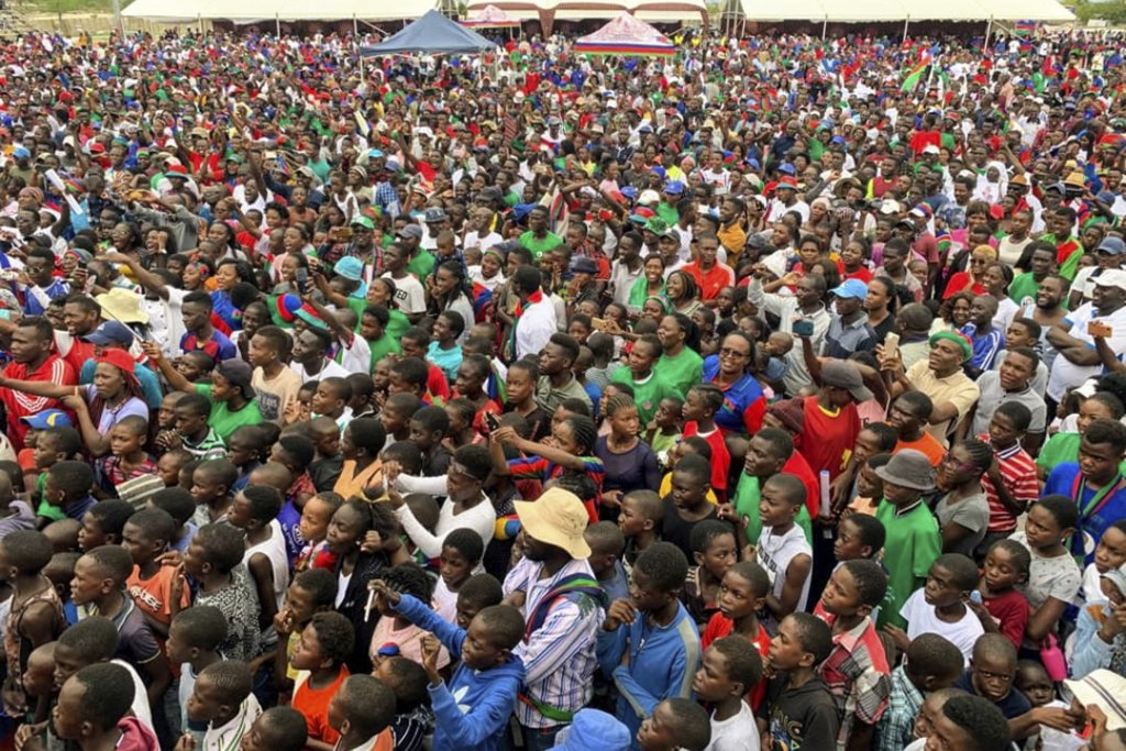 Supporters attend an election rally by Namibian President Hage Geingob in Grootfontein, Namibia Thursday, Nov. 21, 2019. Namibia votes Wednesday in an...