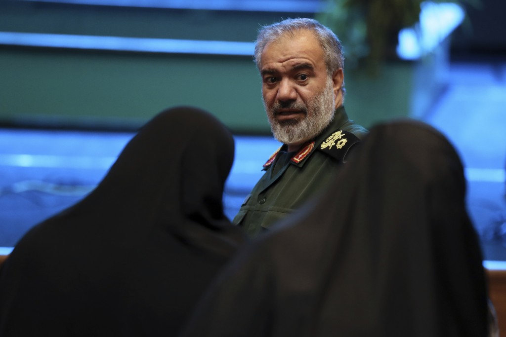 Deputy commander of the Iran's Revolutionary Guard Gen. Ali Fadavi speaks with two female members of the Guard-affiliated Basij paramilitary force in ...