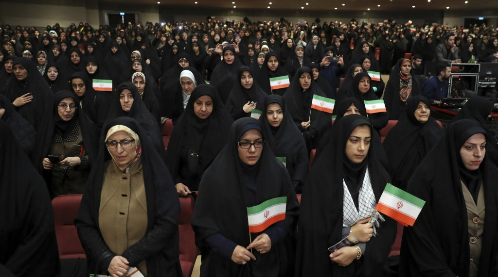 Female members of the the Basij paramilitary force affiliated to the Iran's Revolutionary Guard stand at attention for the national anthem in one of t...