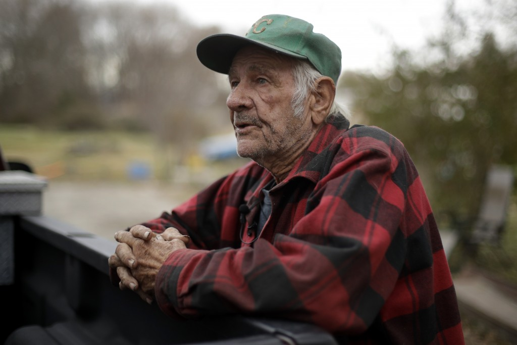In this photo taken Monday, Nov. 18, 2019, Elmer Sullivan talks about his decision not to participate in buyout of homes in Mosby, Mo. About half of t...