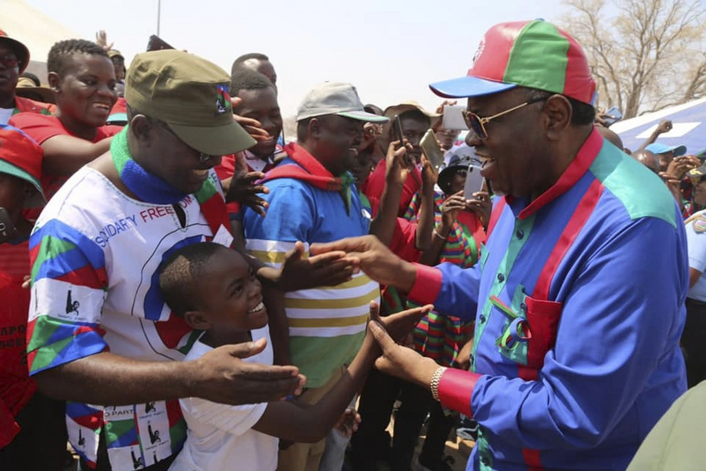 Namibian President Hage Geingob, right, greets supporters at an election rally in Grootfontein, Namibia, Thursday, Nov. 21, 2019. Namibia votes Wednes...