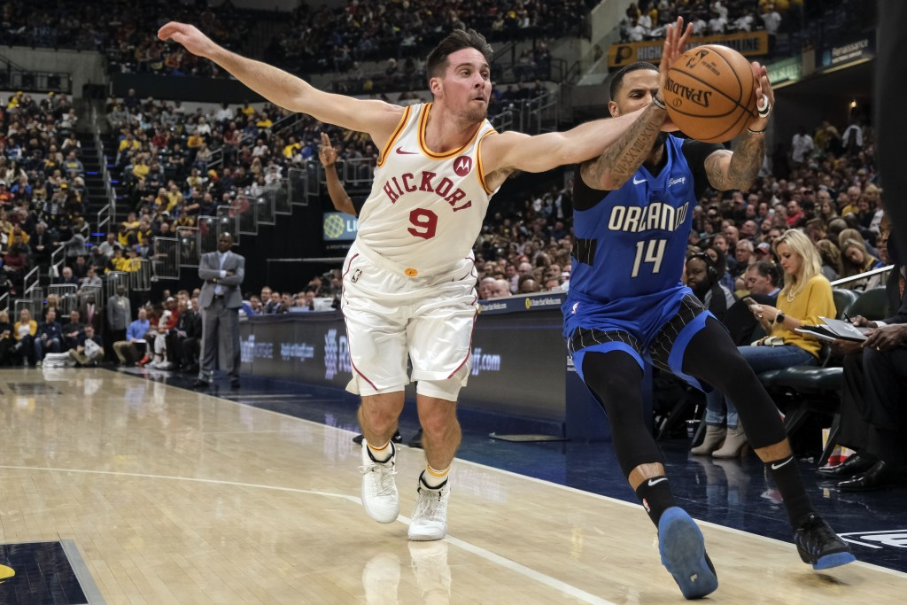 Indiana Pacers guard T.J. McConnell (9) goes after a loose ball against Orlando Magic guard D.J. Augustin (14) during the first half of an NBA basketb...