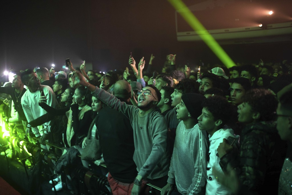 In this Friday, Nov. 22, 2019 photo, rap music fans attend a concert for Moroccan rappers as part of the Visa for Music festival in Rabat, Morocco. (A...