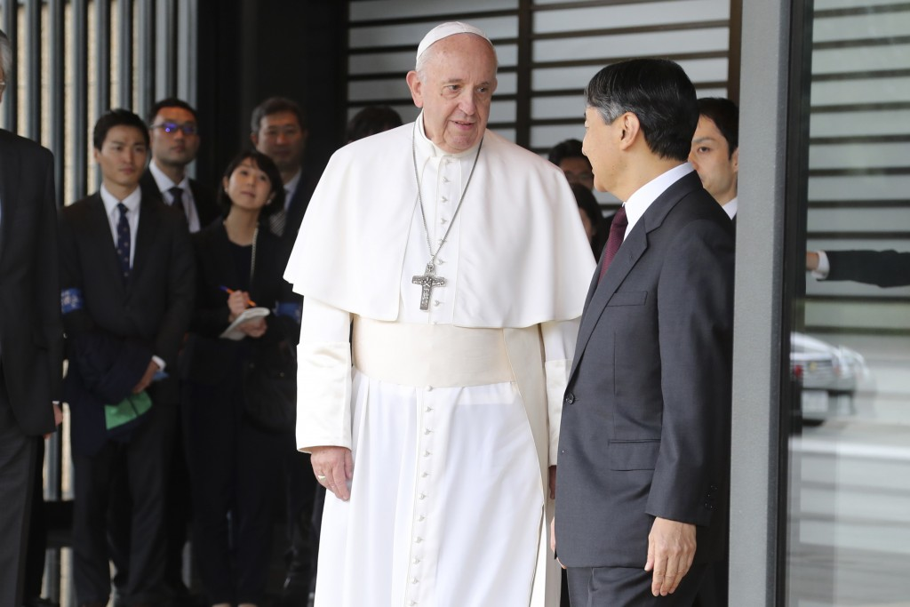 Pope Francis, center, prepares to leave after meeting with Japan's Emperor Naruhito, right, at the Imperial Palace in Tokyo, Monday, Nov. 25, 2019. (A...