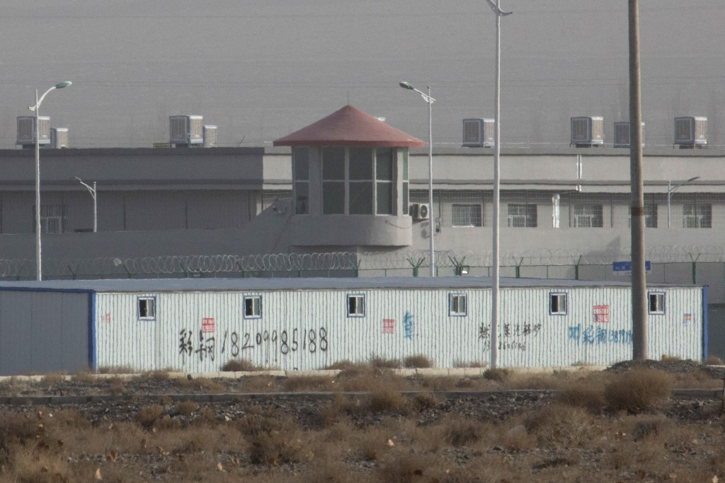 FILE.- In this Monday, Dec. 3, 2018, file photo, a guard tower and barbed wire fences are seen around a facility in the Kunshan Industrial Park in Art...