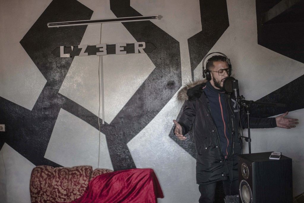 In this Thursday, Nov. 21, 2019 photo, Moroccan rapper Yahya Semlali, 31, known as LZ3er, performs one of his songs during an interview with the Assoc...