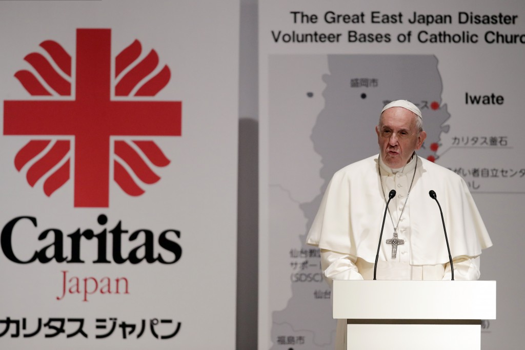 Pope Francis delivers his speech as he meets with victims of the March 11, 2011 Fukushima nuclear plant disaster in northern Japan Monday, Nov. 25, 20...