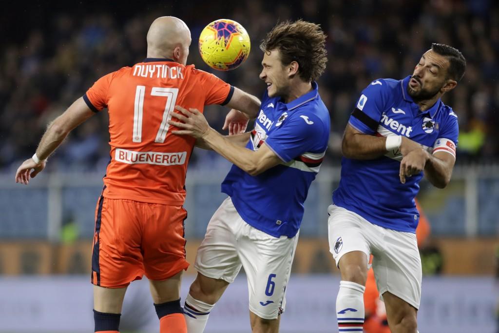 From left, Udinese's Bram Nuytinck, Sampdoria's Albin Ekdal and Sampdoria's Fabio Quagliarella vie for the ball during the Serie A soccer match betwee...