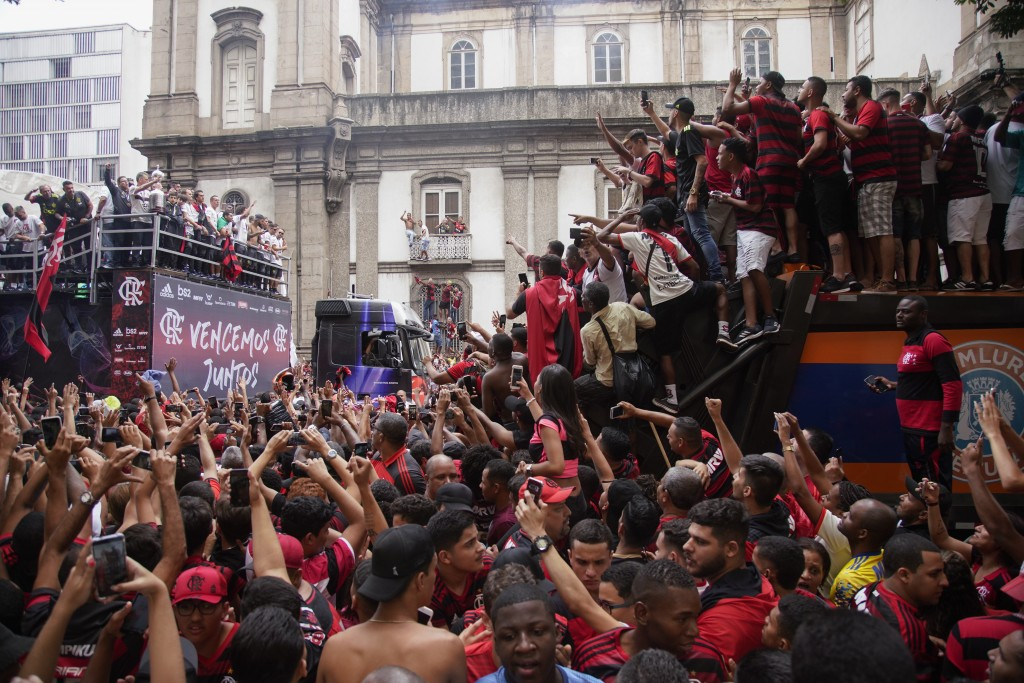 Players of Brazil's Flamengo parade at their arrival in Rio de Janeiro, Brazil, Sunday, Nov. 24, 2019. Flamengo overcame Argentina's River Plate 2-1 i...