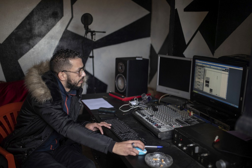 In this Thursday, Nov. 21, 2019 photo, Moroccan rapper Yahya Semlali, 31, known as LZ3er, works in his studio in Fes, Morocco. (AP Photo/Mosa'ab Elsha...