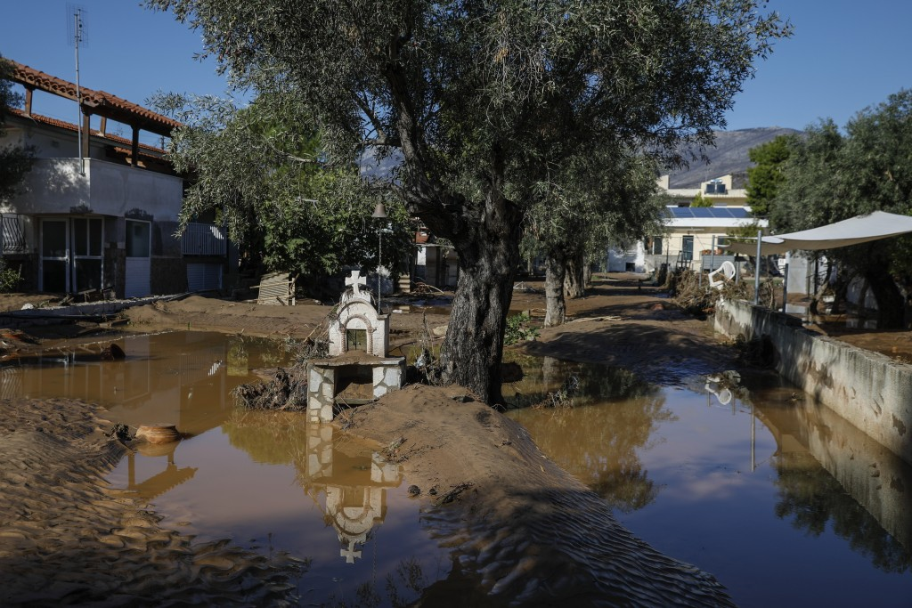 A road is covered with mud after storms in Kineta village, about 68 kilometers (42 miles) west of Athens, Monday, Nov. 25, 2019. Authorities in Greece...