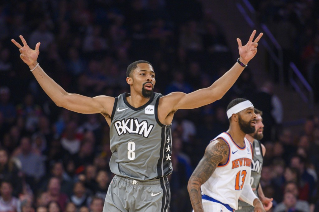 Brooklyn Nets guard Spencer Dinwiddie (8) celebrates a three-point basket in the first half of an NBA basketball game against the New York Knicks, Sun...
