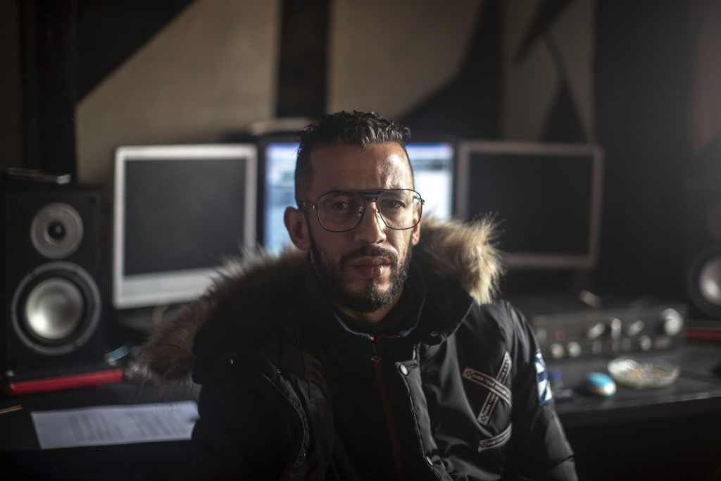 In this Thursday, Nov. 21, 2019 photo, Moroccan rapper Yahya Semlali, 31, known as LZ3er, poses for a portrait in his studio in Fes, Morocco. (AP Phot...