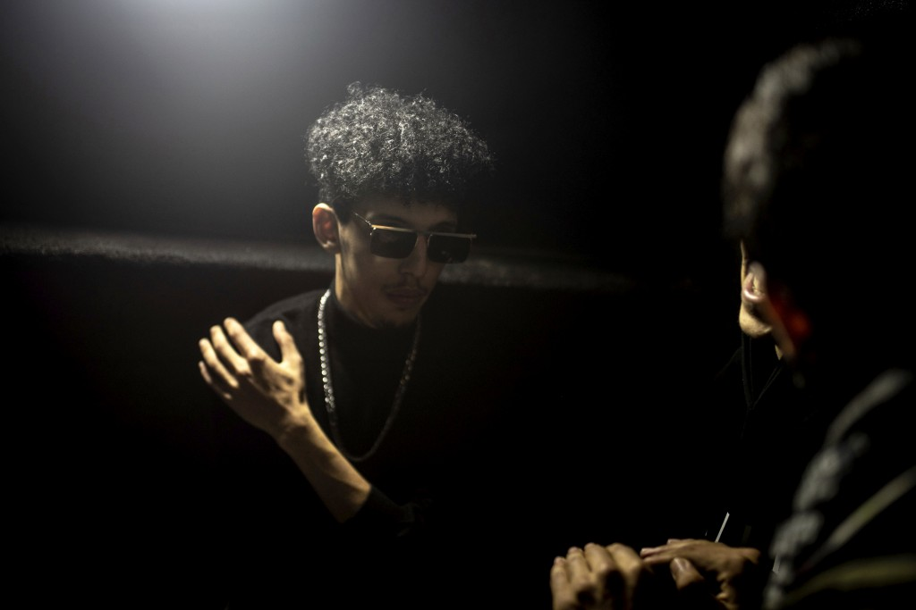 In this Friday, Nov. 22, 2019 photo, Moroccan rapper Abdelkrim Bouhjir, known as Kouz1, prepares to perform in a rap concert as part of the Visa for M...