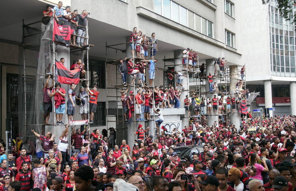 Fans of Brazil's Flamengo watch the team victory parade at their arrival in Rio de Janeiro, Brazil, Sunday, Nov. 24, 2019. Flamengo overcame Argentina...