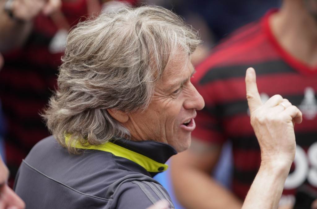 Jorge Jesus, coach of Brazil's Flamengo parades with the team at their arrival in Rio de Janeiro, Brazil, Sunday, Nov. 24, 2019. Flamengo overcame Arg...