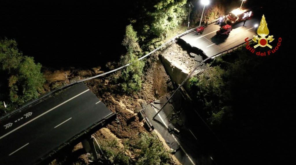 This picture made available Monday, Nov. 25, 2019 shows the collapsed stretch of the Turin to Savona A6 highway, which plunged into a wooded area of t...