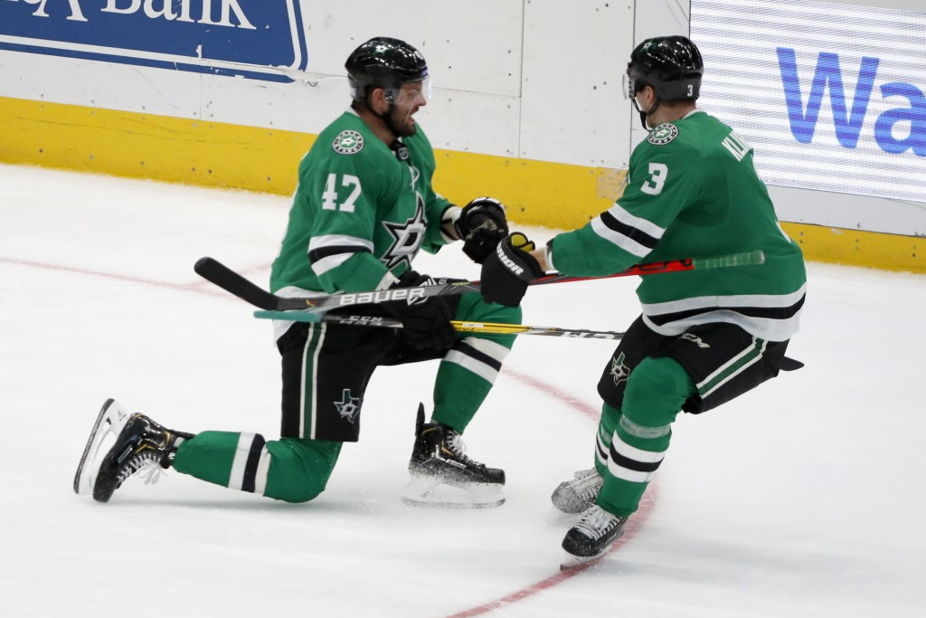 Dallas Stars right wing Alexander Radulov (47) celebrates scoring a goal with defenseman John Klingberg (3) in the third period of an NHL hockey game ...