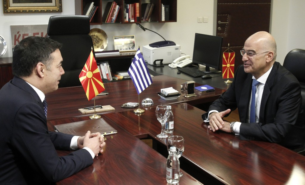 Greek Foreign Minister Nikos Dendias, right, talks with his North Macedonia's counterpart Nikola Dimitrov, left, at the ministry of foreign affairs in...