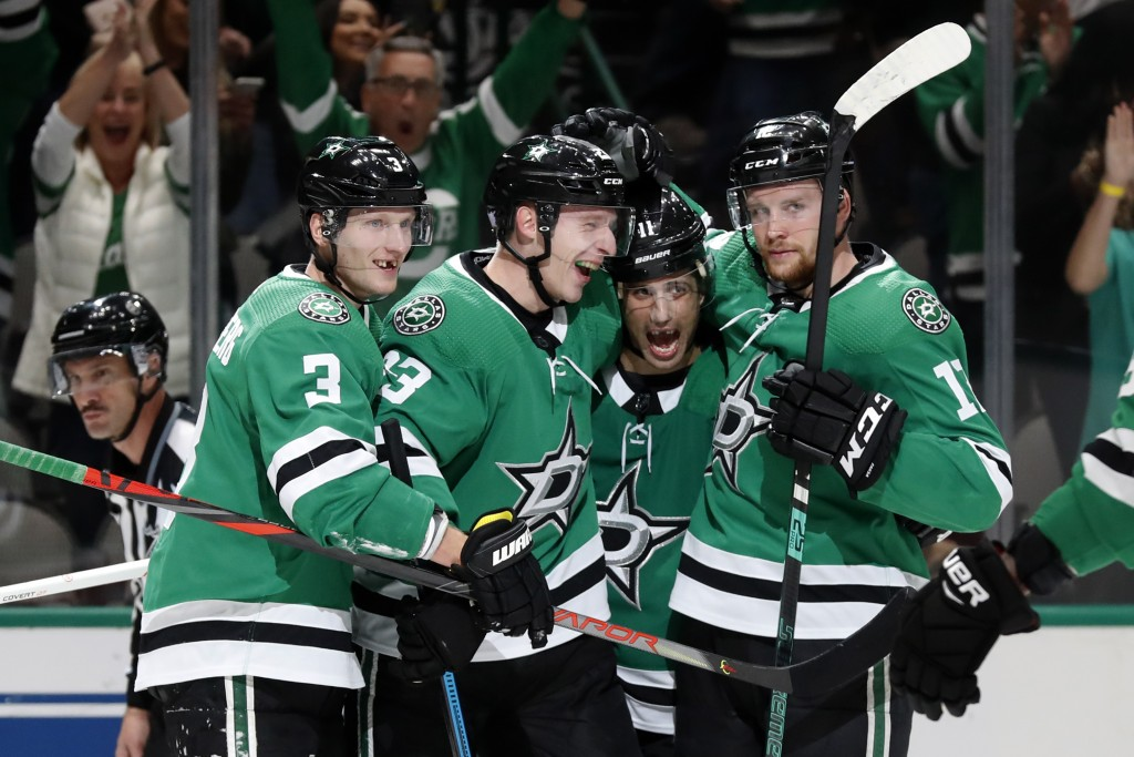 Dallas Stars' John Klingberg (3), Esa Lindell, Andrew Cogliano (11) and Radek Faksa, right, celebrate a goal scored by Lindell in the first period of ...