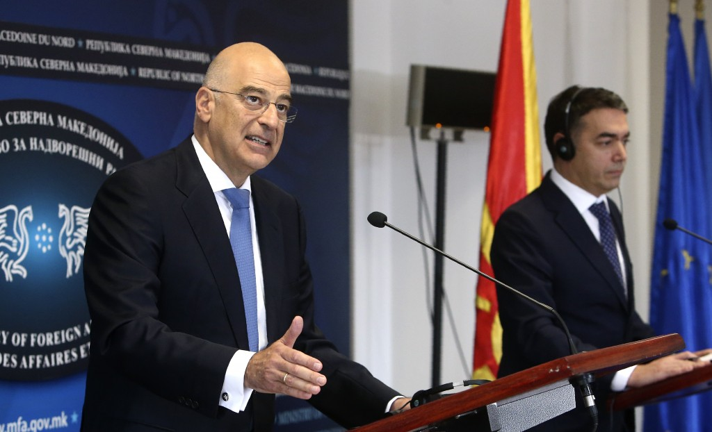 Greek Foreign Minister Nikos Dendias, left, talks for the media during a news conference with his North Macedonia's counterpart Nikola Dimitrov, right...