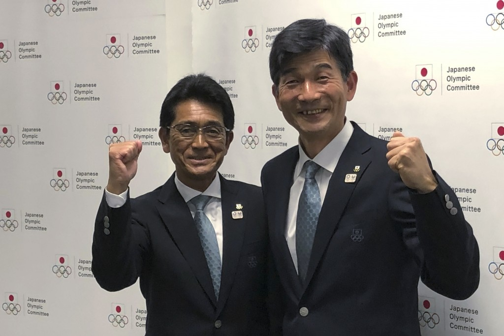 Tsuyoshi Fukui, left, poses with Mitsugi Ogata during a press conference in Tokyo Tuesday, Nov. 26, 2019. Fukui was named  to head Japan's team at nex...