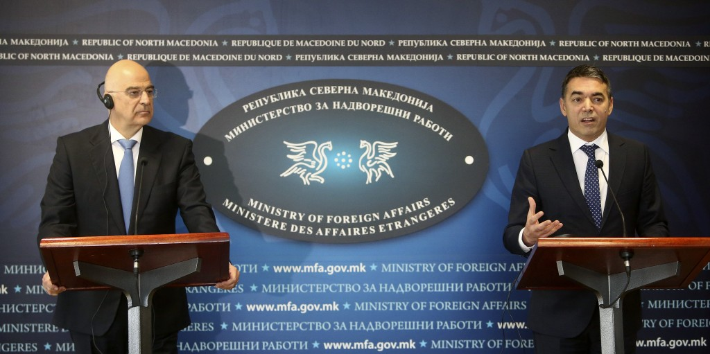 Greek Foreign Minister Nikos Dendias, left and his North Macedonia's counterpart Nikola Dimitrov, right, hold a news conference after their meeting in...