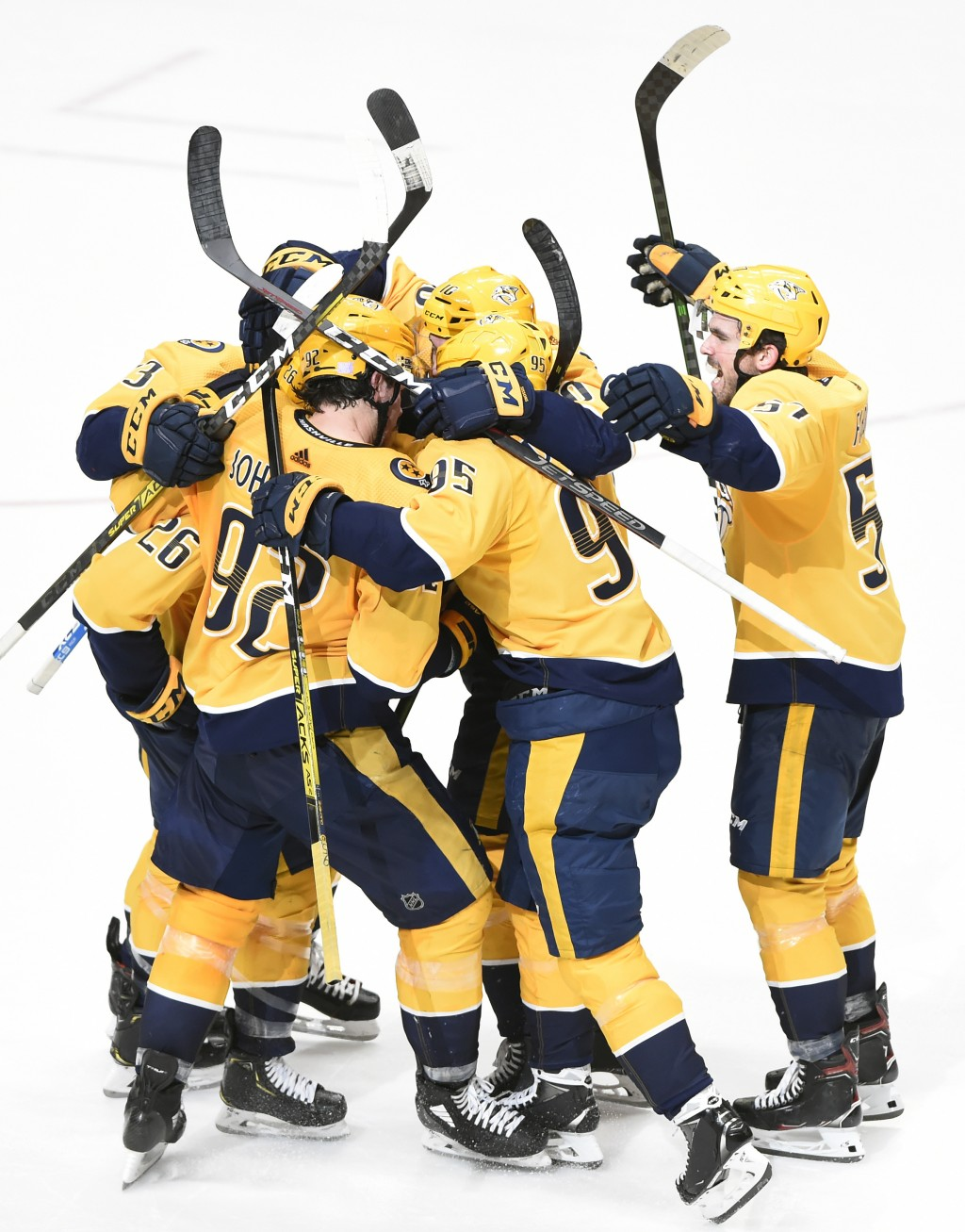 Nashville Predators left wing Daniel Carr is mobbed by teammates after scoring the winning goal against the St. Louis Blues during a shootout in an NH...