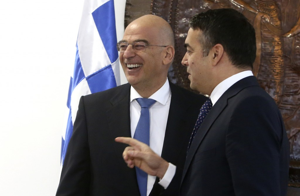 Greek Foreign Minister Nikos Dendias, left, is welcomed by his North Macedonia's counterpart Nikola Dimitrov, right, at the ministry of foreign affair...